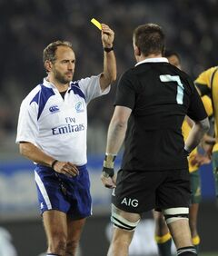New Zealand's Richie McCaw is yellow carded by referee Romain Poite against Australia in their international test Bledisloe Cup rugby match at Eden Park in Auckland, New Zealand, Saturday, Aug. 23 2014. (AP Photo/SNPA, Ross Setford) NEW ZEALAND OUT