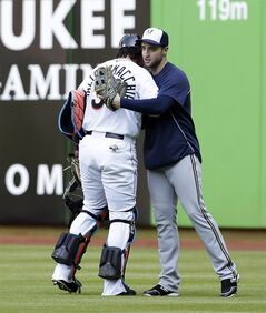 Milwaukee Brewers right fielder Ryan Braun, right, greets Miami Marlins catcher Jarrod Saltalamacchia before a baseball game in Miami, Friday, May 23, 2014. (AP Photo/Alan Diaz)