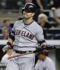 Cleveland Indians first baseman Nick Swisher (33) reacts after striking out to end a baseball game against the New York Yankees, Friday, Aug. 8, 2014, in New York. The Yankees won 10-6. (AP Photo/Julie Jacobson)