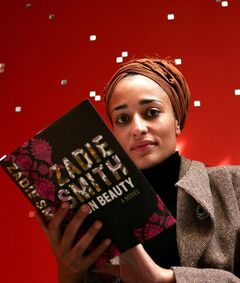 FILE - In this Sept. 19, 2005 file photo, British author Zadie Smith poses with her book,