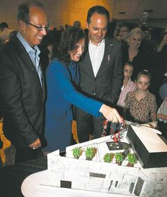 The WAG launches its 100th anniversary celebrations with the help of over 7,500 enthusiastic visitors, including Mayor Sam Katz (from left), Naomi Levine, WAG board president, and Stephen Borys, WAG executive director, cutting the cake replica of the gallery building.