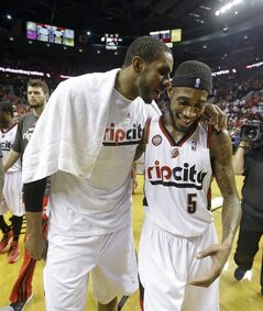 Portland Trail Blazers' LaMarcus Aldridge, left, and Will Barton (5) walk off the court following Game 4 of a Western Conference semifinal NBA basketball playoff series against the San Antonio Spurs Monday, May 12, 2014, in Portland, Ore. The Portland Trail Blazers won 103-92. (AP Photo/Rick Bowmer)