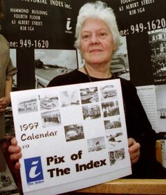 Thora Cooke displays a historical calendar in this 1996 photograph.