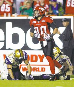 Winnipeg's Johnny Sears (right) and Ian Logan are beaten for a TD reception by Calgary Stampeder receiver Johnny Forzani on Friday night.