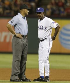 Texas Rangers manager Ron Washington, right, questions a call by second base umpire C.B. Bucknor (54) during the sixth inning of a baseball game against the Miami Marlins in Arlington, Texas, Tuesday, June 10, 2014. The Marlins won 8-5. (AP Photo/LM Otero)