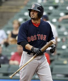 Boston Red Sox's Shane Victorino looks back at the mound after striking out against Texas Rangers' Yu Darvish in the first inning of a baseball game, Friday, May 9, 2014, in Arlington, Texas. (AP Photo/Tony Gutierrez)