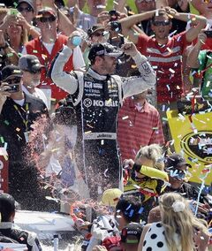 Jimmie Johnson celebrates in Victory Lane after the NASCAR Quicken Loans 400 auto race at Michigan International Speedway in Brooklyn, Mich., Sunday, June 15, 2014. (AP Photo/Carlos Osorio)