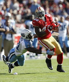Tennessee Titans linebacker Gerald McRath tries to bring down San Francisco 49ers tight end Delanie Walker in 2009.