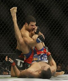 Danny Castillo, top, punches Tony Ferguson during the first round of a lightweight mixed martial arts bout at UFC 177 in Sacramento, Calif., Saturday, Aug. 30, 2014. Ferguson won by split decision. (AP Photo/Jeff Chiu)