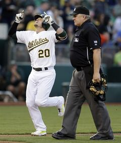 Oakland Athletics' Josh Donaldson (20) celebrates as he runs past home plate umpire Bill Miller after hitting a home run against the Toronto Blue Jays in the third inning of a baseball game on Saturday, July 5, 2014, in Oakland, Calif. (AP Photo/Ben Margot)