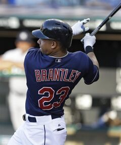 Cleveland Indians' Michael Brantley hits an RBI-double off New York Yankees starting pitcher Masahiro Tanaka in the first inning of a baseball game Tuesday, July 8, 2014, in Cleveland. Jason Kipnis scored on the play. (AP Photo/Tony Dejak)