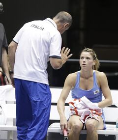 Italy's Camila Giorgi, right, talks with coach Corrado Barazzutti during a Fed Cup world group tennis match against the United States Saturday, Feb. 8, 2014, in Cleveland. Giorgi defeated Madison Keys in two sets. (AP Photo/Tony Dejak)