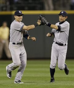 New York Yankees outfielders Ichiro Suzuki, right, and Jacoby Ellsbury, left, celebrate after the Yankees beat the Mariners 3-2 in a baseball game, Tuesday, June 10, 2014, in Seattle. (AP Photo/Ted S. Warren)