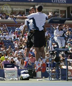 Bob, left, and Mike Bryan react after defeating Scott Lipsky and Rajeev Ram in a semifinal doubles match during the 2014 U.S. Open tennis tournament, Thursday, Sept. 4, 2014, in New York. (AP Photo/Julio Cortez)