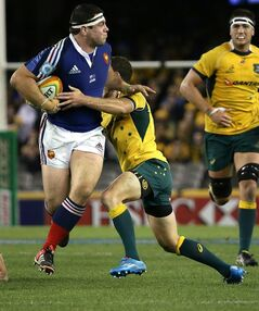 France's Guilhem Guirado, left, is tackled by Australia's Nic White, during their rugby test match in Melbourne, Australia, Saturday, June 14, 2014. (AP Photo/Hamish Blair)