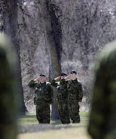 Army reservists from 38 Canadian Brigade Group participate in Friday's ceremony at Brookside Cemetery's Field of Honour.