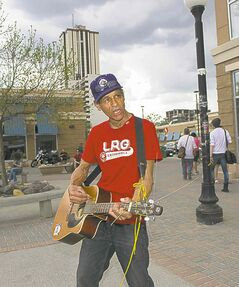 Eric Pyle, better known as Eric the Great, busks in Osborne Village Square.