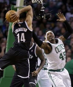 Brooklyn Nets guard Shaun Livingston (14) vies for control of the ball with Boston Celtics forward Gerald Wallace (45) in the first quarter of an NBA basketball game, Sunday, Jan. 26, 2014, in Boston. (AP Photo/Steven Senne)