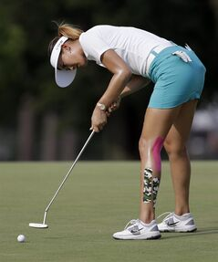 Michelle Wie putts on the 14th hole during the first round of the LPGA U.S. Women's Open golf tournament in Pinehurst, N.C., Thursday, June 19, 2014. (AP Photo/Bob Leverone)