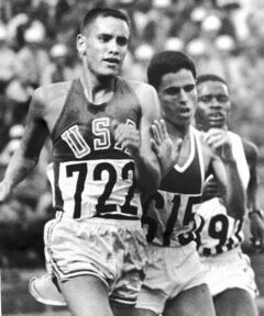 Billy Mills (722) surges to victory in the 10,000-meter Olympic race in Tokyo in 1964. He has been a champion in his post-Olympic life, too.