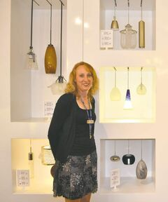 Robinson Lighting branch manager Alison Demare with a display of drop lights.