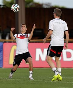 Germany's national soccer player Philipp Lahm stops a ball during a training session in Santo Andre near Porto Seguro, Brazil, Tuesday, June 10, 2014. Germany will play in group G of the 2014 soccer World Cup. (AP Photo/Matthias Schrader)