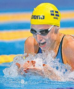 Sweden's Jennie Johansson swims in a 100-metre breaststroke heat at the worlds in Barcelona, Spain, Monday.