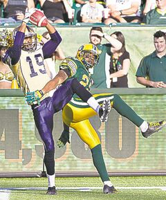 Bombers� Aaron Kelly provided one of few highlights, pulling in this grab with Eskimos� Joe Burnett all over him.