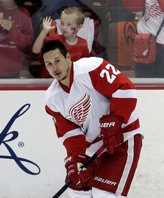 Detroit Red Wings right wing Jordin Tootoo warms up as a young fan watches prior to Game 7 of their first-round NHL hockey Stanley Cup playoff series against the Anaheim Ducks in Anaheim, Calif., Sunday, May 12, 2013.A person familiar with the move has confirmed to The Associated Press that the Detroit Red Wings have placed forward Tootoo on waivers with the intention to buy out the final year of his contract. THE CANADIAN PRESS/AP/Chris Carlson