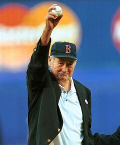 FILE - In this June 11, 1999, file photo, Boston Red Sox Hall of Famer Ted Williams winds up to throw out the ceremonial first pitch before a baseball game between the Red Sox game and the New York Mets in New York. Fans can see hundreds of items once owned by Red Sox slugger Ted Williams at a preview of the first major auction of his sports, military and personal memorabilia during a public preview starting Wednesday, April 25, 2012, through Friday at Fenway Park. The auction will be Saturday and some of the proceeds will benefit The Jimmy Fund, the official Red Sox charity. (AP Photo/Bill Kostroun, File)