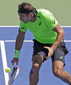 Marinko Matosevic, from Austrailia, volleys against John Isner during a match at the Western & Southern Open tennis tournament, Wednesday, Aug. 13, 2014, in Mason, Ohio. Isner won 6-3, 7-6 (1). (AP Photo/Al Behrman)