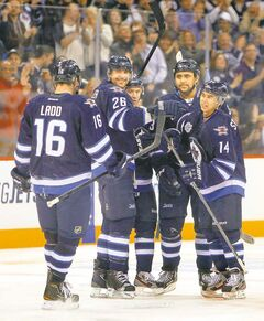 Winnipeg Jet Blake Wheeler (26) beams at team captain Andrew Ladd as he, Bryan Little, Dustin Byfuglien and Tim Stapleton  celebrate their fourth goal Thursday at the MTS Centre.