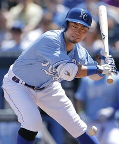 Kansas City Royals' Norichika Aoki dodges an inside pitch by Detroit Tigers starting pitcher Justin Verlander during the first inning of a baseball game at Kauffman Stadium in Kansas City, Mo., Sunday, May 4, 2014. (AP Photo/Orlin Wagner)