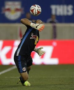 New York Red Bulls goalkeeper Luis Robles deflects a shot by the Columbus Crew during the second half of an MLS soccer match, Saturday, July 12, 2014, in Harrison, N.J. (AP Photo/Julio Cortez)