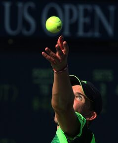 Dominic Thiem, of Austria, serves against Ernests Gulbis, of Latvia, during the second round of the 2014 U.S. Open tennis tournament, Friday, Aug. 29, 2014, in New York. (AP Photo/John Minchillo)