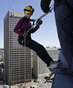 Jennifer Ford begins to rappel down 17 stories of the RBC building on Portage Avenue last year, taking part in the annual Easter Seals Drop Zone. All proceeds raised stay in Manitoba to support Manitobans with disabilities.