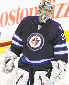 Goalie Ondrej Pavelec stopped 18 of 21 shots Saturday.