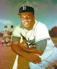 FILE - Brooklyn Dodgers baseball player Jackie Robinson poses in 1952. Kansas City's Negro Leagues Baseball Museum is hosting an advance screening of an upcoming movie about Robinson, who broke major league baseball's color barrier. Thomas Butch of the financial firm Waddell and Reed announced Wednesday, March 20, 2013 that actors Harrison Ford and Andre Holland will be among those appearing at an April 11 screening of