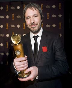 Director Denis Villeneuve holds up his award for the most notable film outside of Quebec for his the movie Incendies at the Jutra awards in Montreal on March 11, 2012. A slew of Canadian filmmakers are slated to make big Hollywood splashes in 2013, with hyped releases including Vancouver-based Neill Blomkamp's hotly anticipated followup to