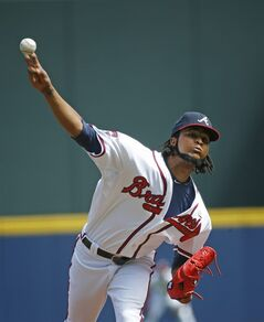 Atlanta Braves starting pitcher Ervin Santana (30) works against the Philadelphia Phillies in the first inning of a baseball game Wednesday, Sept. 3, 2014, in Atlanta. (AP Photo/John Bazemore)