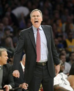 FILE - In this Feb. 21, 2014, file photo, Los Angeles Lakers head coach Mike D'Antoni yells at referees during the second half of an NBA basketball game against the Boston Celtics in Los Angeles. D'Antoni has resigned after less than two seasons on the job. Lakers spokesman John Black confirmed D'Antoni's resignation Wednesday, April 30. (AP Photo/Mark J. Terrill, File)