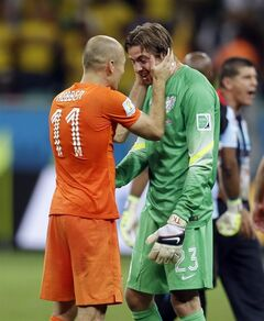 Netherlands' Arjen Robben congratulates goalkeeper Tim Krul after the Netherlands defeated Costa Rica 4-3 in a penalty shootout after a 0-0 tie during the World Cup quarterfinal soccer match at the Arena Fonte Nova in Salvador, Brazil, Saturday, July 5, 2014. (AP Photo/Natacha Pisarenko)