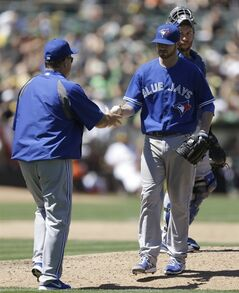 Toronto Blue Jays' Drew Hutchison, right, hands the ball to manager John Gibbons as he is removed from baseball game against the Oakland Athletics in the sixth inning Sunday, July 6, 2014, in Oakland, Calif. (AP Photo/Ben Margot)