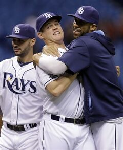 Tampa Bay Rays' Jerry Sands, center, celebrates with David Price, right, and Sean Rodriguez, left, after the team defeated the Baltimore Orioles 5-4 during a baseball game Monday, June 16, 2014, in St. Petersburg, Fla. Sands hit an eighth inning, two-run home run. (AP Photo/Chris O'Meara)