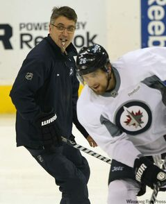 Coach Claude Noel, left, skates with Blake Wheeler.