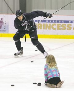 Olli Jokinen went for a skate at the MTS Iceplex Thursday. His daughter Emma, 8, slides him pucks to practise his one-timers.