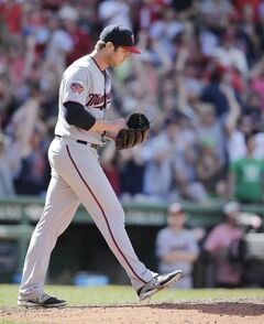 Minnesota Twins relief pitcher Casey Fien walks to the mound after giving up the game-tying home run to Boston Red Sox designated hitter David Ortiz in the 10th inning of a baseball game at Fenway Park in Boston, Wednesday, June 18, 2014. The Red Sox won Twins 2-1 in 10 innings. (AP Photo/Charles Krupa)