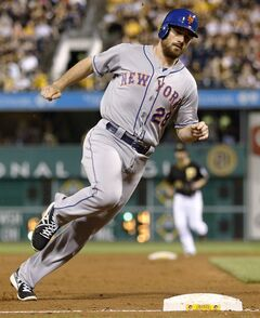 New York Mets' Daniel Murphy (28) rounds third base on his way to score on a double by David Wright in the eighth inning of the baseball game against the Pittsburgh Pirates on Thursday, June 26, 2014, in Pittsburgh. The Pirates won 5-2. (AP Photo/Keith Srakocic)