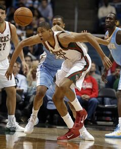 Milwaukee Bucks' Giannis Antetokounmpo (34) eyes a loose ball against the Denver Nuggets during the second half of an NBA basketball game Thursday, Feb. 20, 2014, in Milwaukee. (AP Photo/Jeffrey Phelps)