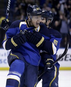 St. Louis Blues' Alexander Steen, front, is congratulated by Barret Jackman after scoring during the second period in Game 5 of a first-round NHL hockey Stanley Cup playoff series against the Los Angeles Kings on Wednesday, May 8, 2013, in St. Louis. It could be a season to remember for the Blues, according to a video game simulation of the 2013-14 NHL campaign.THE CANADIAN PRESS/AP/Jeff Roberson